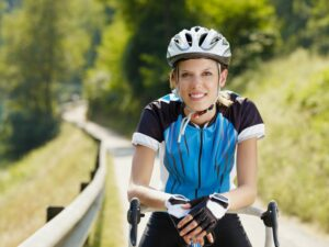 young woman on road bike